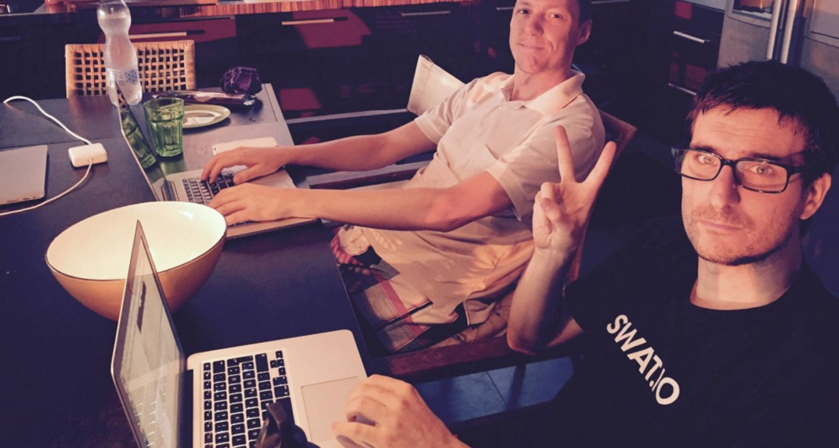 Johannes (in the front) coding along at their company retreat