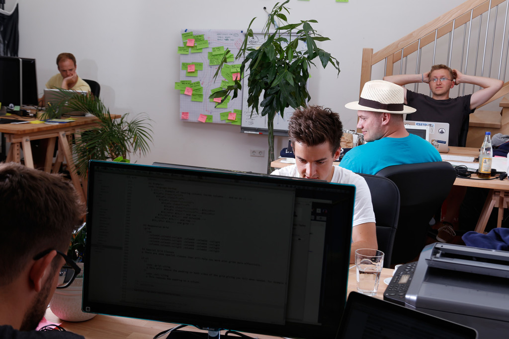 Florian (in the back) and the Codeship team at work